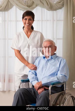 USA, Illinois, Metamora, Portrait of female nurse with senior man on wheelchair - Stock Photo