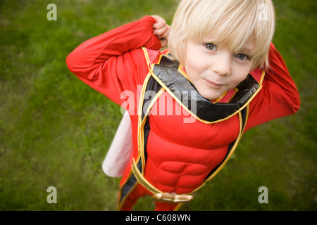 A young boy dressed as a superhero. - Stock Photo