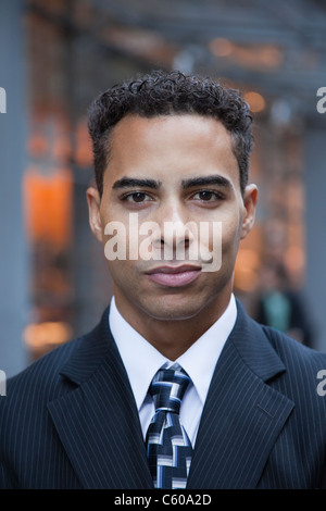 USA, New York, New York City, portrait of smiling businessman on street - Stock Photo