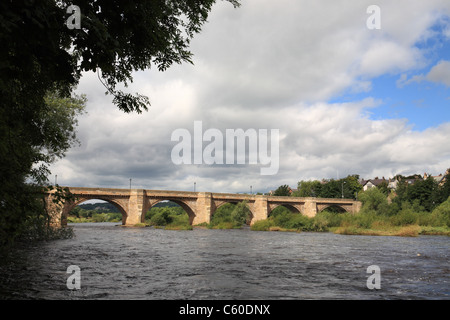 The 17th century seven arched stone bridge over the river Tyne at Corbridge, Northumberland, north east England, - Stock Photo