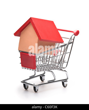 Shopping cart with red roofed house over white - Stock Photo