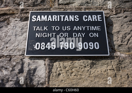 A Samaritans suicide 0845 helpline sign on Brunel's Clifton suspension bridge in Bristol. - Stock Photo