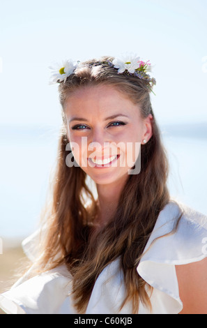 Woman wearing daisy crown - Stock Photo