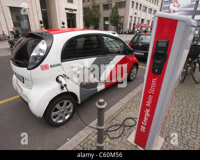 Flinkster DB carsharing electric car being recharged on street in Berlin German - Stock Photo
