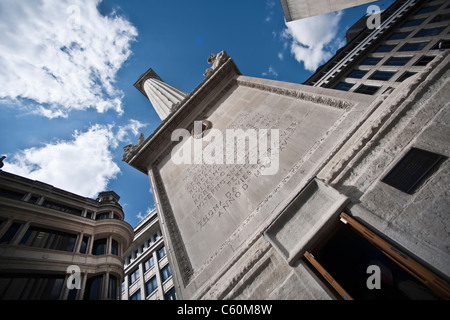 Monument on city street against blue sky - Stock Photo