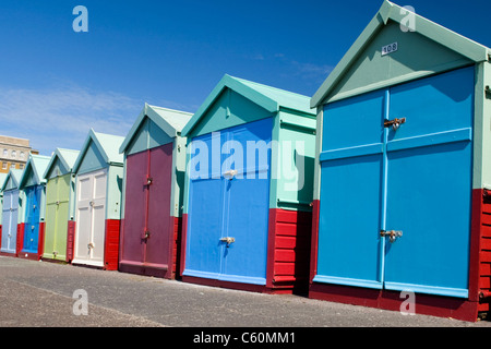 East Sussex , Hove actually , colorful or colourful beach huts on the promenade or seafront - Stock Photo