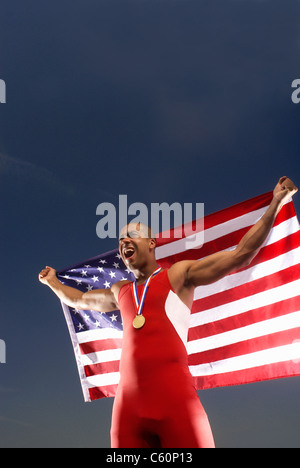 Athlete with medal and American flag - Stock Photo
