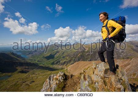 Hiker overlooking landscape - Stock Photo
