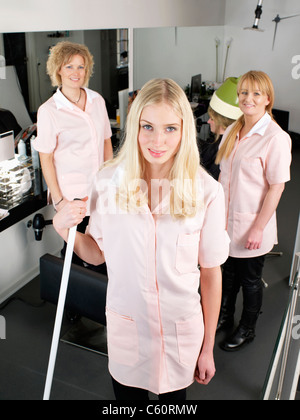 Hairdressers standing in salon - Stock Photo