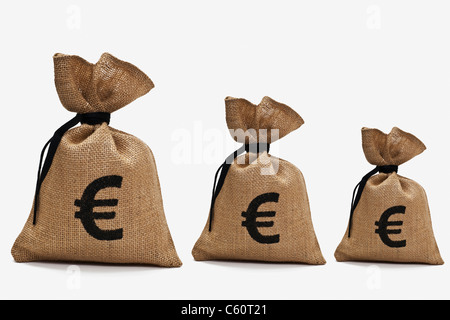 three different big money bags with euro sign next to each other - Stock Photo