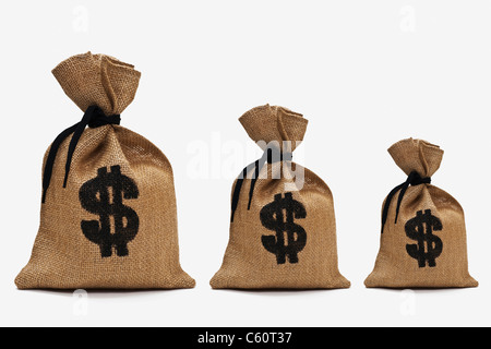 three different big money bags with dollar sign next to each other - Stock Photo