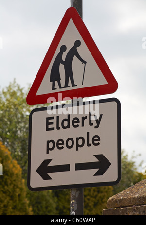 Elderly people crossing road sign in the Cotswolds in July - Stock Photo