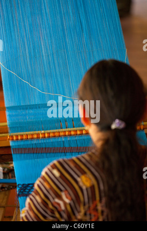 Indigenous woman weaving, Antigua, Guatemala - Stock Photo