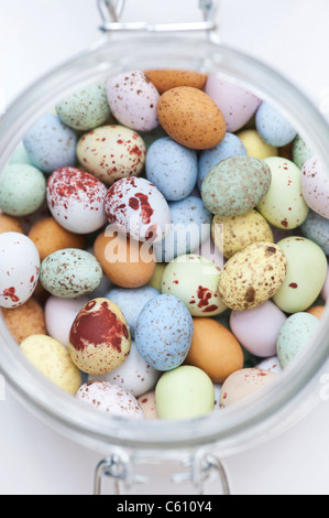 Chocolate mini eggs in a glass jar - Stock Photo