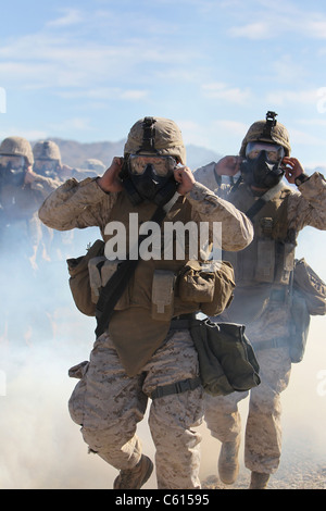 US Marines and sailors in full protective gear marching through the cloud of gas to test with their new gear. Jan - Stock Photo