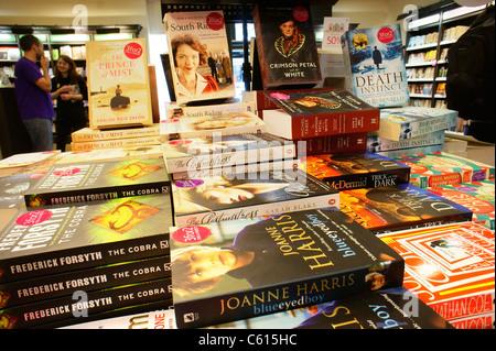 Paperback novels novelist bestseller bestselling writers book display promotion in Waterstones bookshop book shop - Stock Photo
