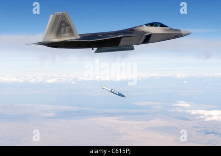 F-22 Raptor releases a 1 000-pound over the Utah Test and Training Range during weapons evaluation. October 20 2005. - Stock Photo