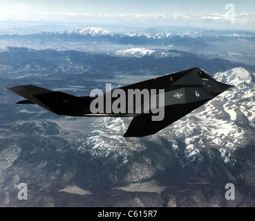 F-117A Nighthawk was the first operational aircraft designed to exploit low-observable stealth technology. Introduced - Stock Photo