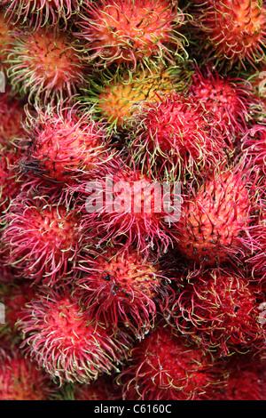 Rambutan for sale in Chinatown market, Kuala Lumpur, Malaysia, Southeast Asia, Asia - Stock Photo
