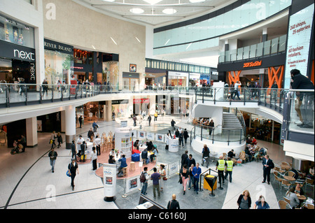 Arndale Centre, Manchester, England. Shoppers and retail outlet stores shops in the pedestrianised city centre shopping - Stock Photo