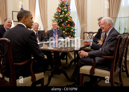 President Obama talks with former President Jimmy Carter during a meeting with National Security Advisor Tom Donilon. - Stock Photo