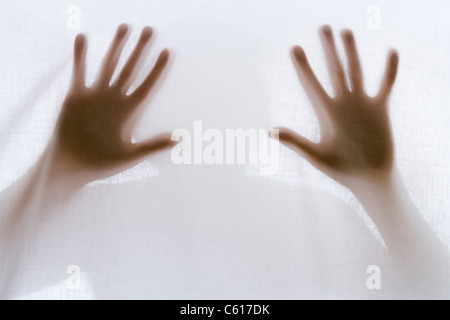 Silhouette of man behind sheet. - Stock Photo