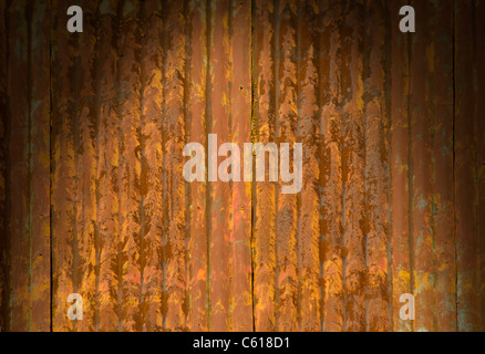 Rusty corrugated metal surface dramatically lit from above - Stock Photo