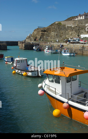 Fishing boats in Portreath harbour near high tide, Cornwall UK. - Stock Photo