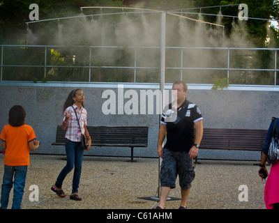 Paris, France, heatwave Tourists in Water Spray on Street, at La Défense Business Center, - Stock Photo