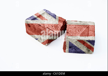 Union Jack on a broken brick on white background . Concept representing the foundation of a broken society - Stock Photo