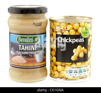 Glass jar container of Bevelini Tahini sesame seed paste and a can of tesco chickpeas in water. - Stock Photo