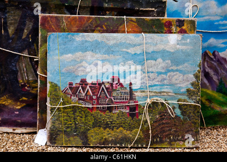 Oil paintings on sale at a village fair, Highgate, London, UK - Stock Photo