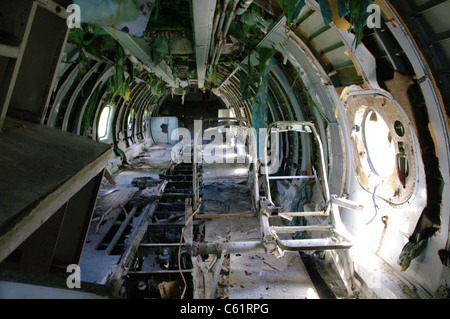 Inside the wreckage of an abandoned AN-26 airplane, Pearls Airport, Grenada - Stock Photo