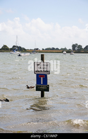 Warning sign about tides in Bosham. - Stock Photo