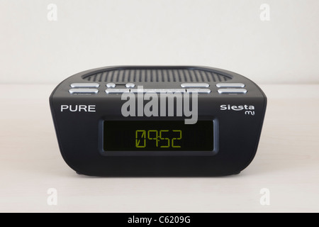 dab digital alarm clock radio and owl wireless led electricity stock photo royalty free image. Black Bedroom Furniture Sets. Home Design Ideas