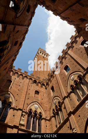 The Torre del Mangia tower in Piazza del Campo,Siena, Italy, view from inside looking up at the rear. - Stock Photo