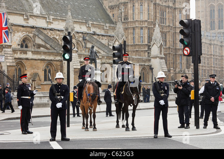 London, England, UK. Policemen and military personnel lining the route at the Royal Wedding of Prince William and - Stock Photo