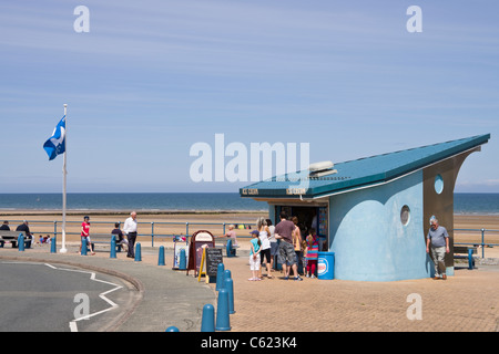 Ice cream parlour selling ice creams on seafront by beach in Welsh seaside resort of Benllech, Anglesey, North Wales, - Stock Photo