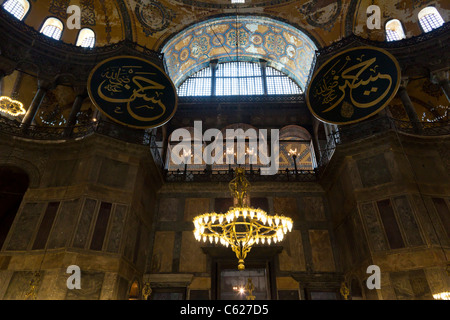 Beautiful balcony with arcs, painted ceiling and chandeliers.Interior of the Aya Sofia Mosque and museum Istanbul, - Stock Photo