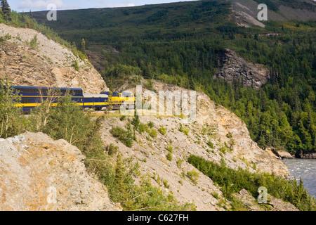 Alaskan Railroad train running alongside the Nenana River in Alaska. - Stock Photo