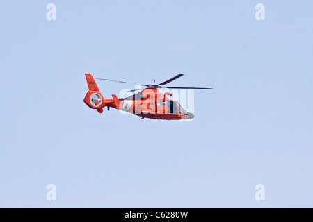 US Coast Guard helicopter over Texas City bay. - Stock Photo