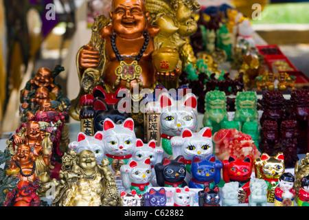 Buddha and cats for sale at Aloha stadium swap meet - Stock Photo