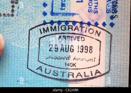 Immigration stamp at Brisbane Airport, Australia stamped in British passport - Stock Photo