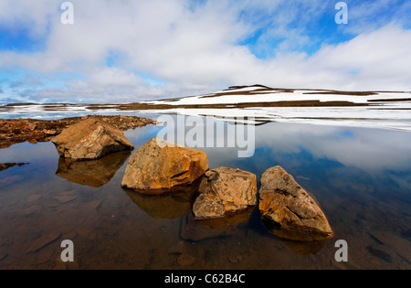 Ice and reflections in a lake, Eastern Fjords, Iceland - Stock Photo
