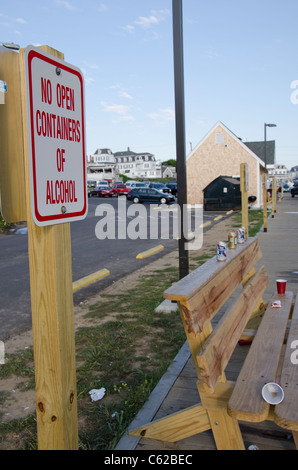 Rhode Island, Block Island (aka New Shoreham). Beer cans on bench with NO alcohol sign. - Stock Photo