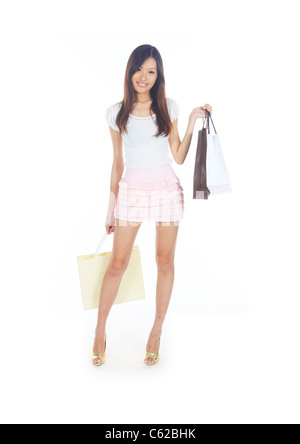 Retail Therapy Concept with Asian Lady and Bags - Stock Photo