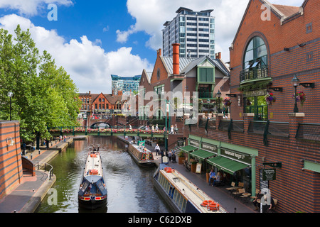 Narrowboats in front of restaurants on the canal at Brindley Place, Birmingham, West Midlands, England, UK - Stock Photo