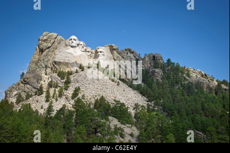 Heads of four American presidents carved in Mount Rushmore in Black Hills South Dakota USA on a sunny summer day - Stock Photo