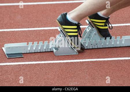 starting blocks on an athletics track - Stock Photo