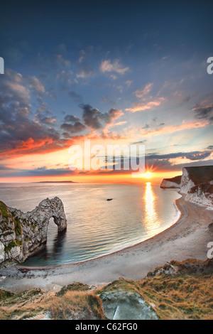 Durdle Door at sunset, Dorset. - Stock Photo